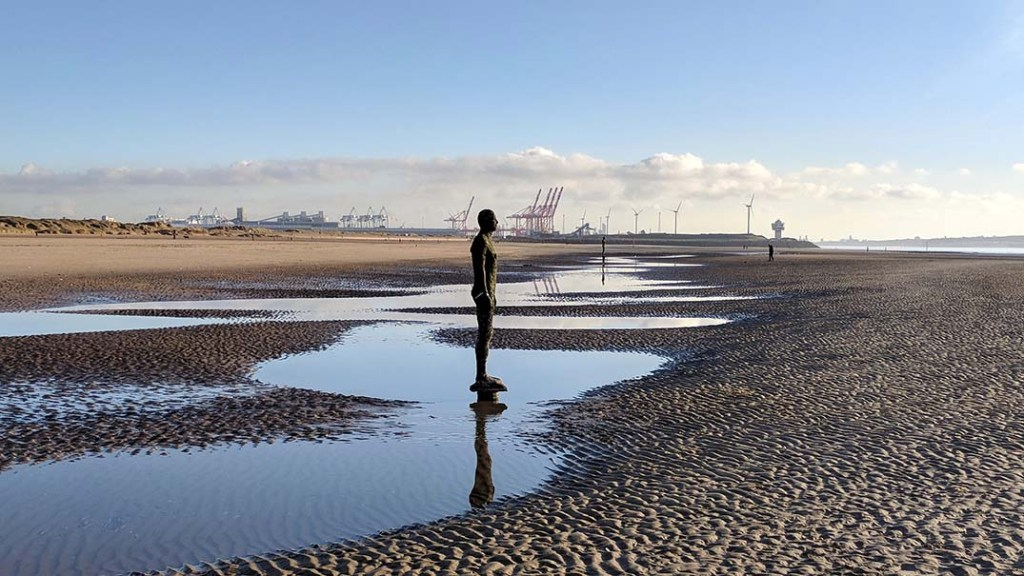 Take caution when walking on the beach at Crosby, Merseyside to explore the 'Another Place' iron men by Anthony Gormley. Fast paced tides can cut you off. From a travel blog by www.traveljunkiegirl.com