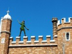 Peter Pan avoids Captain Hook (and the crowds) up on the roof