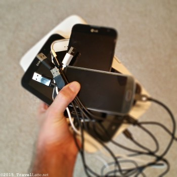 Photo: A handful of smartphones & tablets needing a charger.