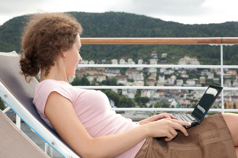 Cruising on the Internet - Checking Email on the Balcony