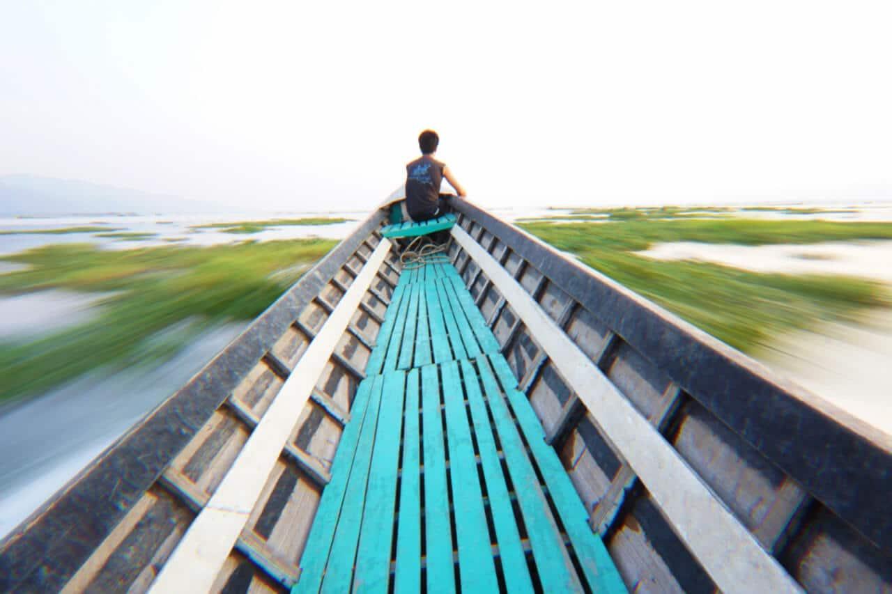 Myanmar photos boat speeds on Lake Inle