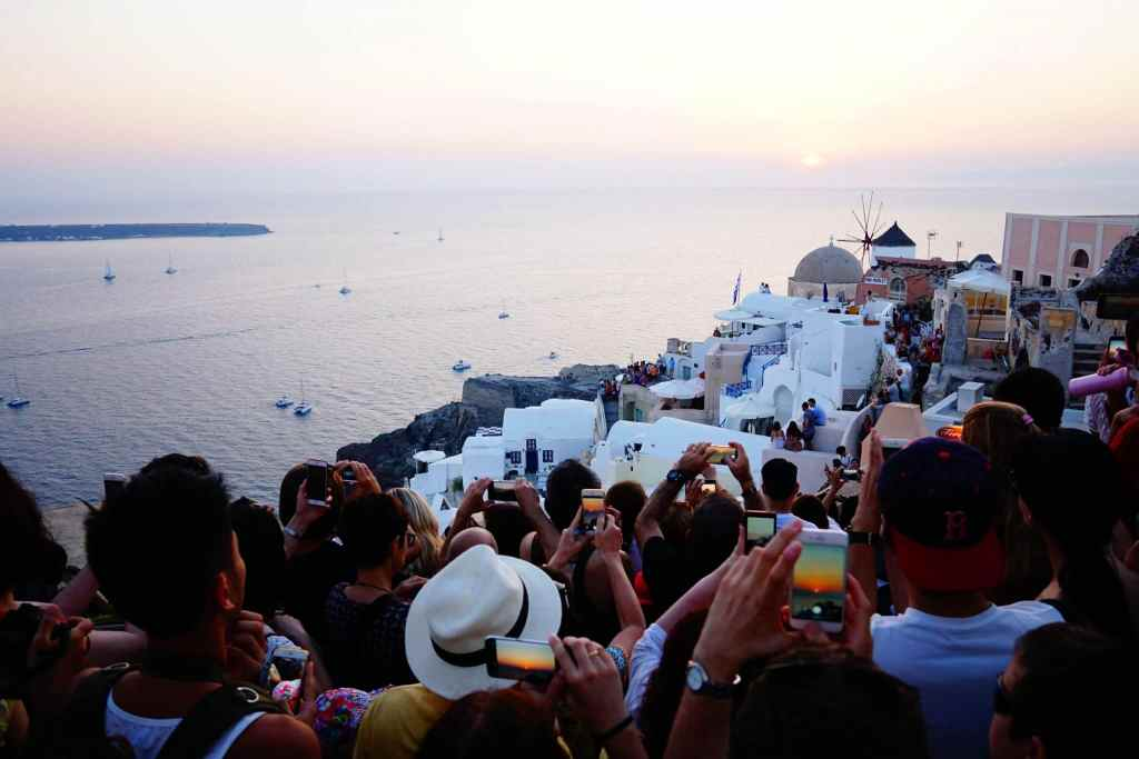 People fighting to get sunset picture in Santorini