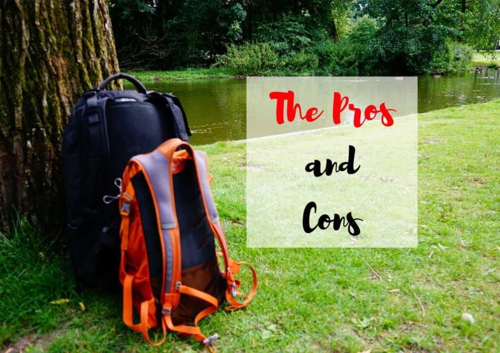 An Osprey Porter and an Osprey Daylite bag sitting against a tree