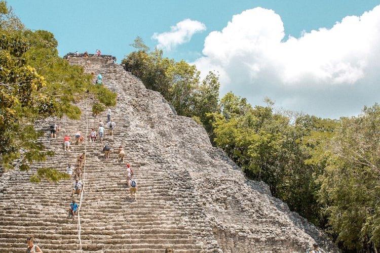 People climb the main pyramid of ixmoja at Nohoch Mul at the Coba Ruins in Mexico