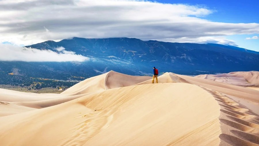 View of a man walking in Great Sand Dunes National Park