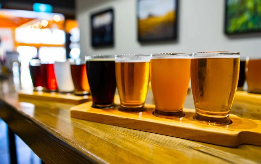 View of different beers on a wooden tray
