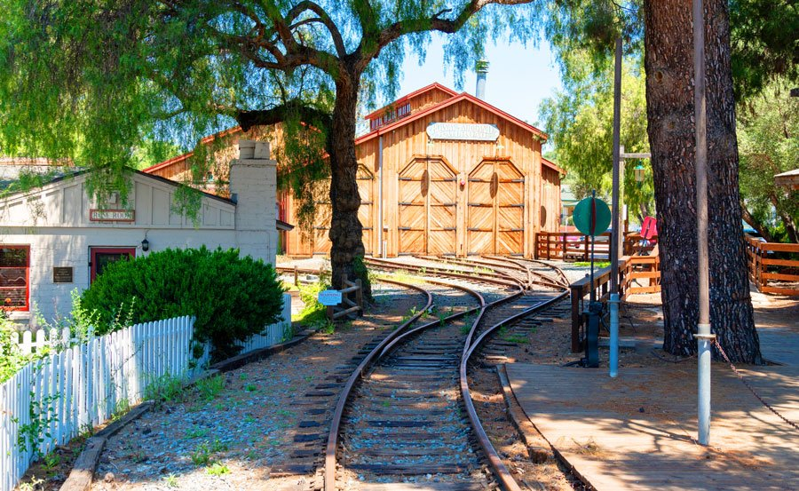View of Old Poway park village and a railroad