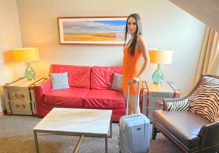 Woman standing in a suite at the Crawford Hotel in Denver
