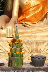 votive offering and Buddha hand