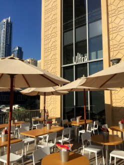 Outdoor seating terrace and entrance from Marina Walk