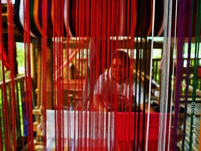 """A """"tubaw"""" weaver demonstrates the weaving process on her loom"""