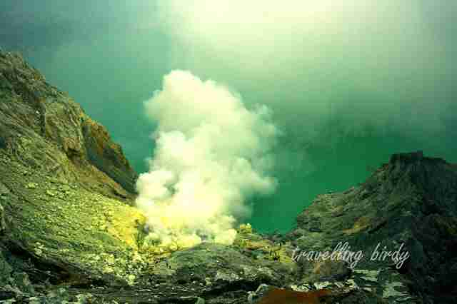 Fumes constantly rise from Kawa Ijen's placid lake
