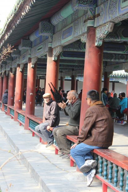 Chinese local playing music in the long corridor east of the Hall of Prayer for Good Harvests