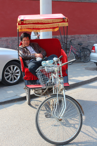 Cycle Rickshaw driver taking a rest