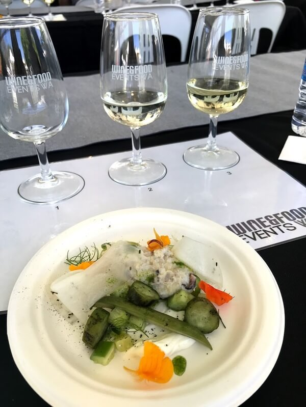 glass-of-redgate-wines-sauvignon-blanc-reserve-white-plate-with-cucumbers-three-ways-daikon-crab-and-smoked-yoghurt