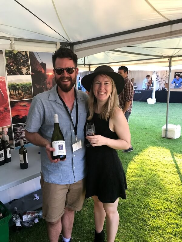 john-from-faber-vineyard-holding-a-bottle-of-grenache-and-naomi-holding-a-glass