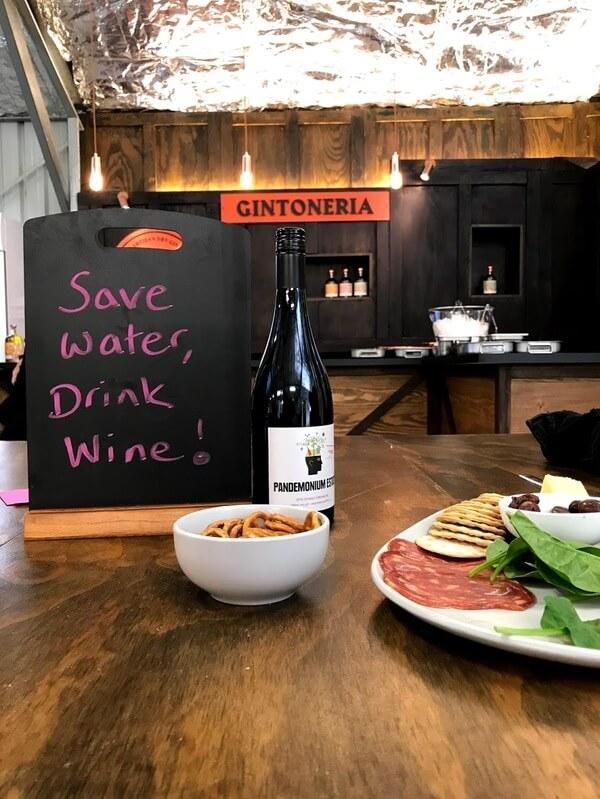 save-water-drink-wine-sign-with pandemonium-estate-wine-bottle