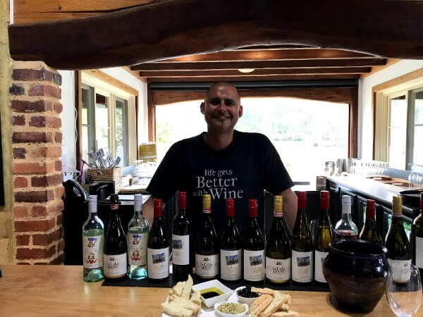 cellar-door-staff-at-the-lake-house-standing-behind-the-selection-of-wines