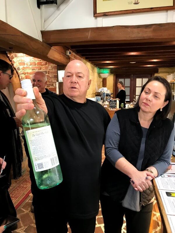 garry-holding-a-bottle-of-lake-house-wine-and-standing-next-to-leanne