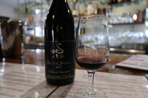 glass-and-bottle-of-cabernet-sauvignon-at-black-swan-winery-swan-valley