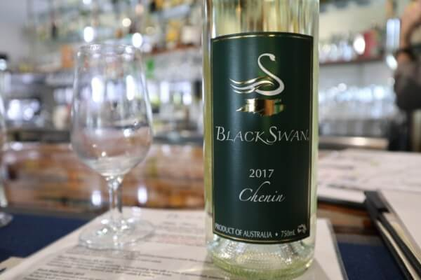 glass-and-bottle-of-chenin-at-black-swan-winery-swan-valley