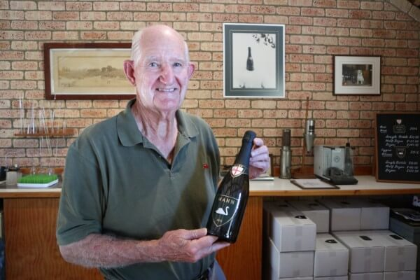 owner-dorham-holding-a-botlle-of-cygne-blanc-at-the-mann-winery-cellar-door-swan-valley