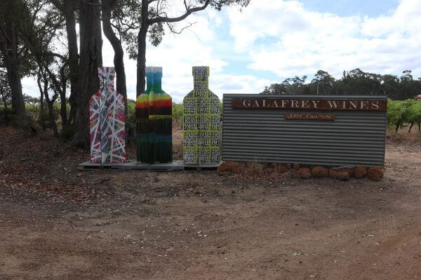 entry into galafrey winery woith three cutout colourful wine bottles