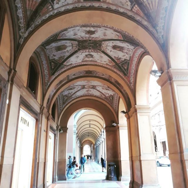 Under the famous arches of Bologna