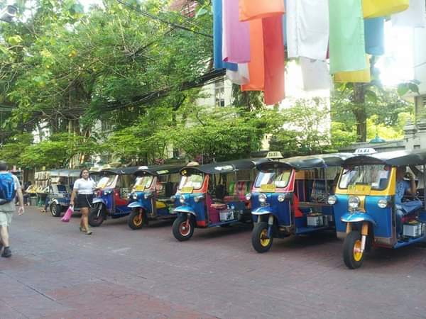 a row of tuk tuks in bangkok