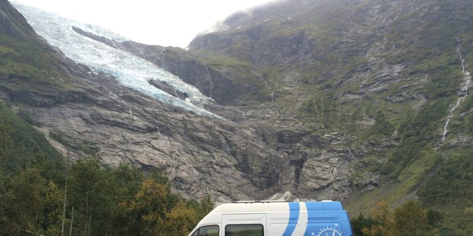 campervan fjord ice snow glacier Renault self build camper van Norway Scandinavia blue rocks mountains vikings