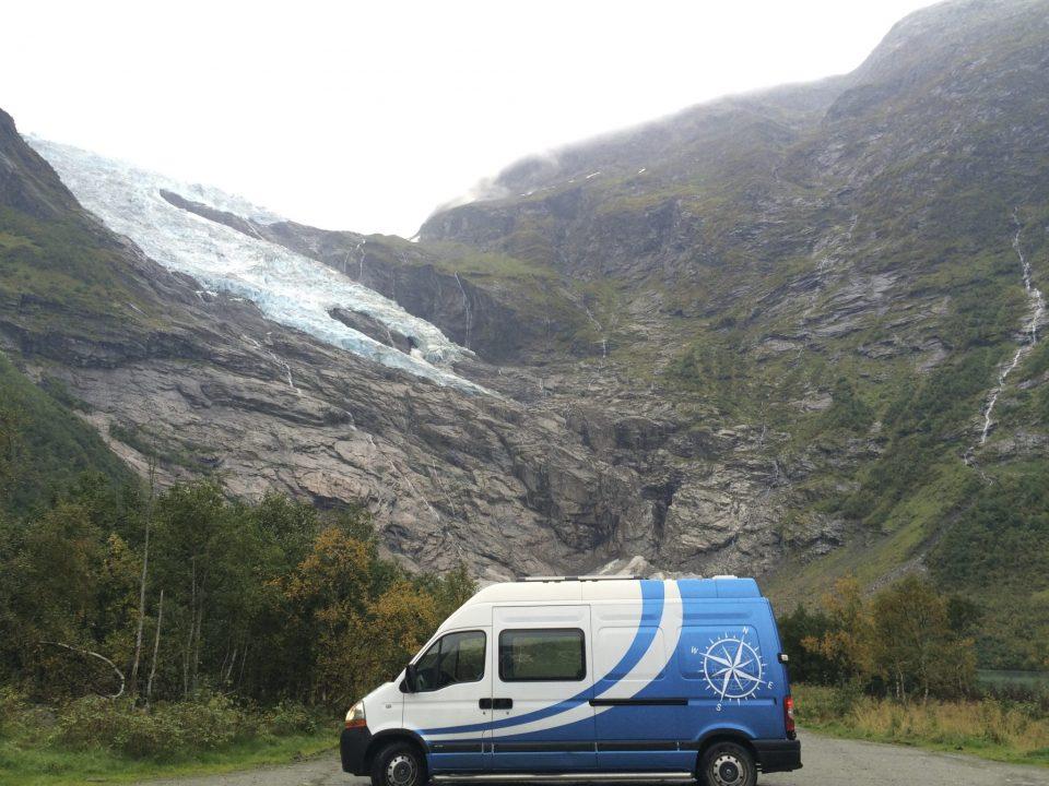 campervan fjord ice snow glacier Renault self build camper van Norway Scandinavia blue rocks mountains vikings