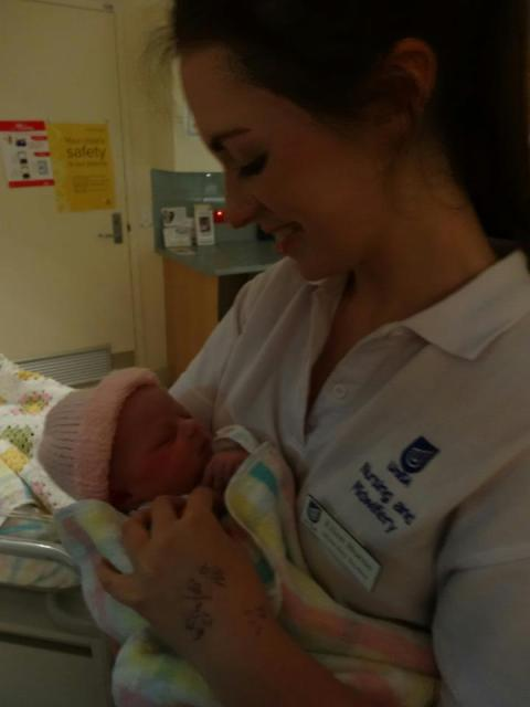 This is me holding my honourary niece Lexi - she was the first baby I ever 'caught' <3