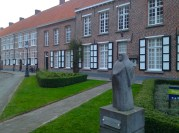 The Begijnhof museum and the quaint statue of the beguin
