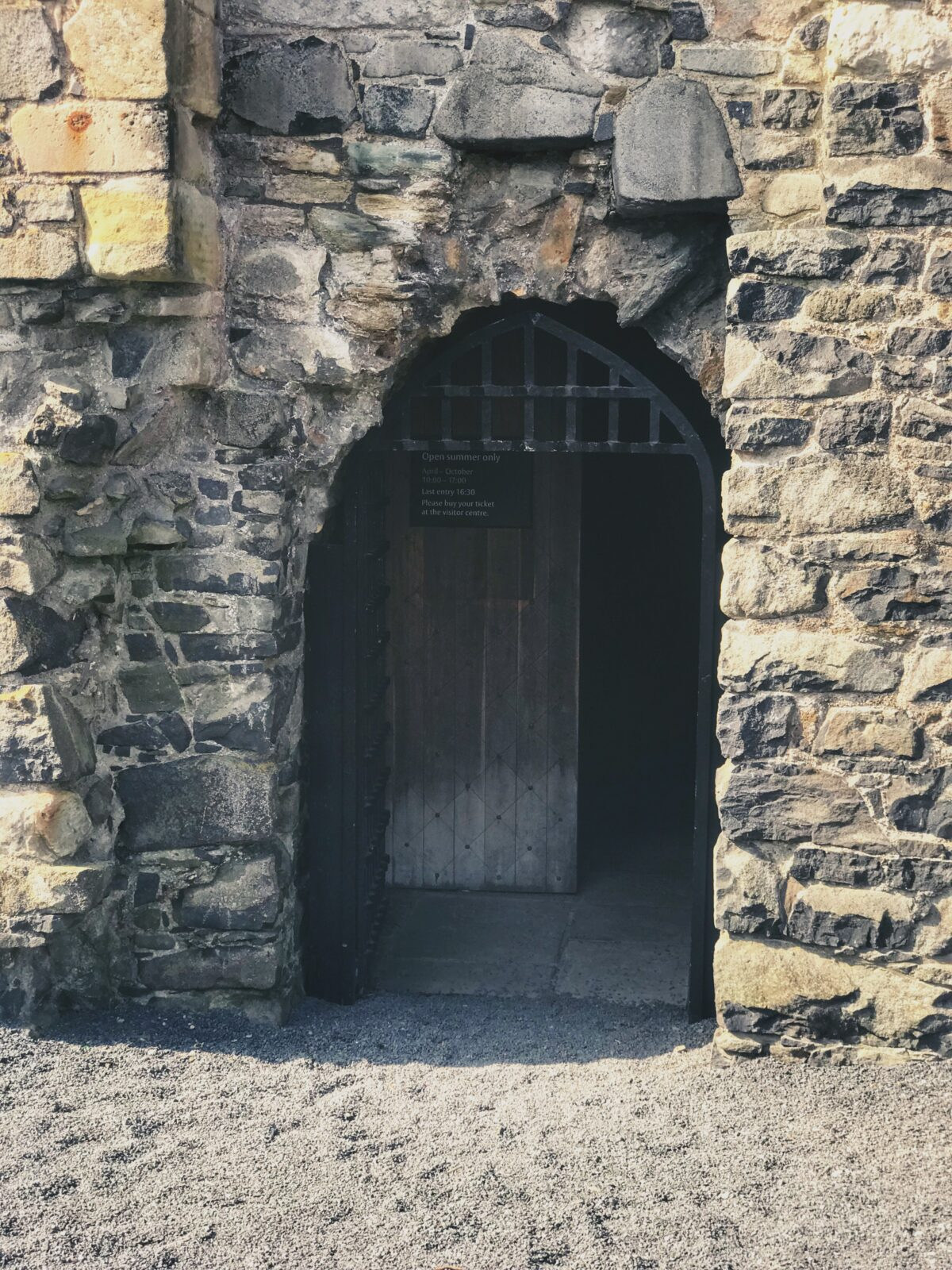 The doorway into Dundonald Castle with an iron arch and door
