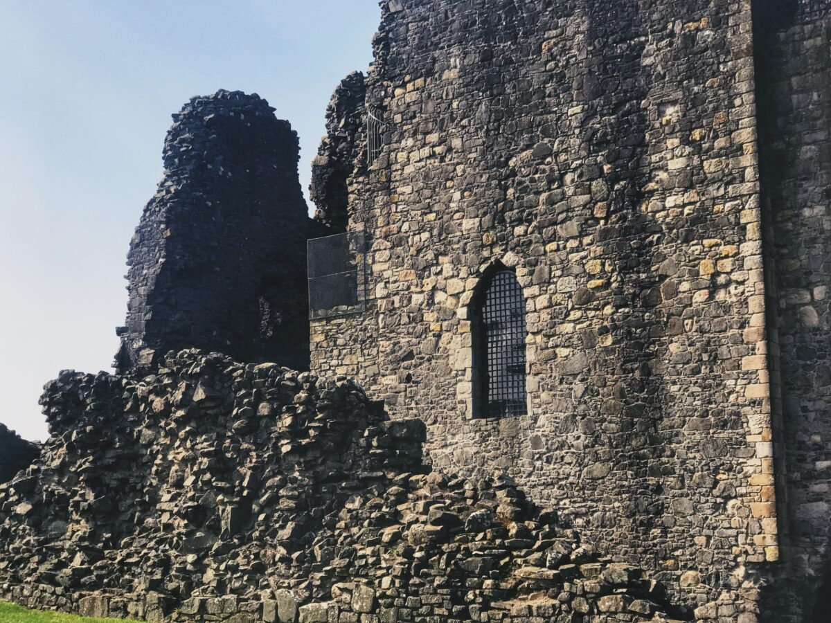 Dundonald castle from the outside with a window in the ruins