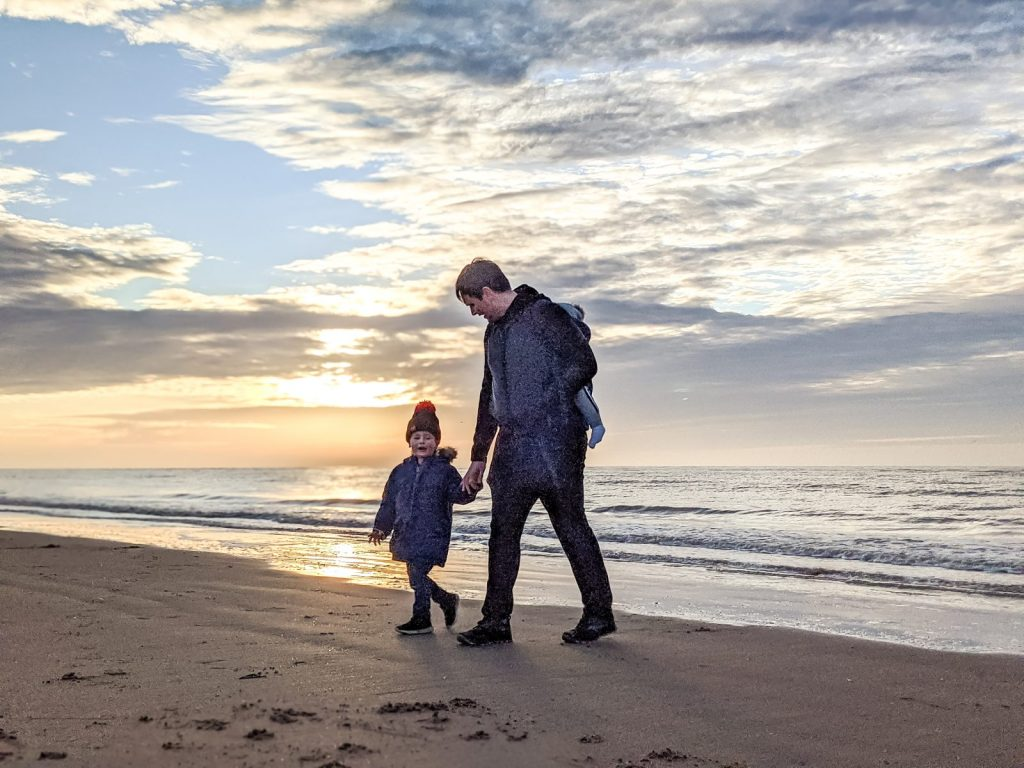 Neil and Dexter walking on Ainsdale beach