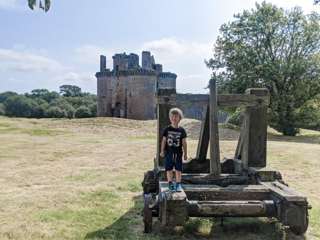 Dexter in front of Caerlaverock castle