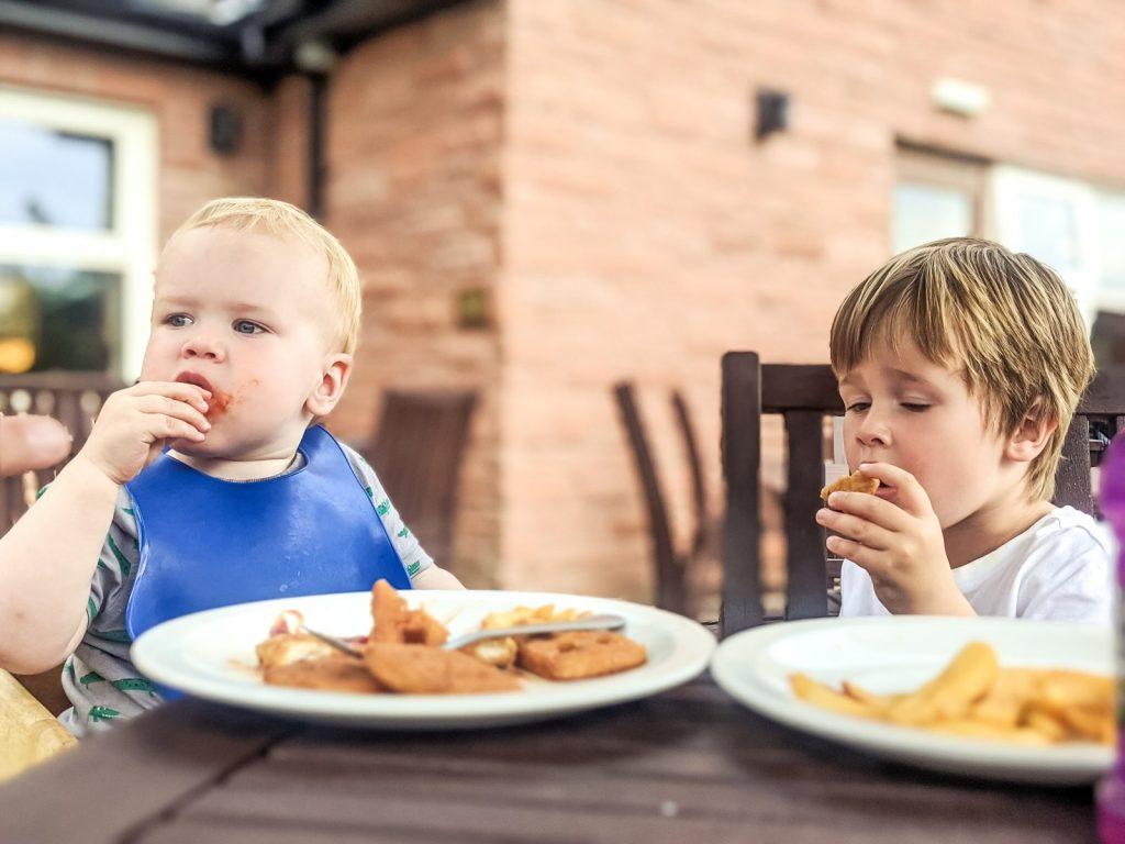 Felix and Dexter eating at Lockards Farm, Dumfries