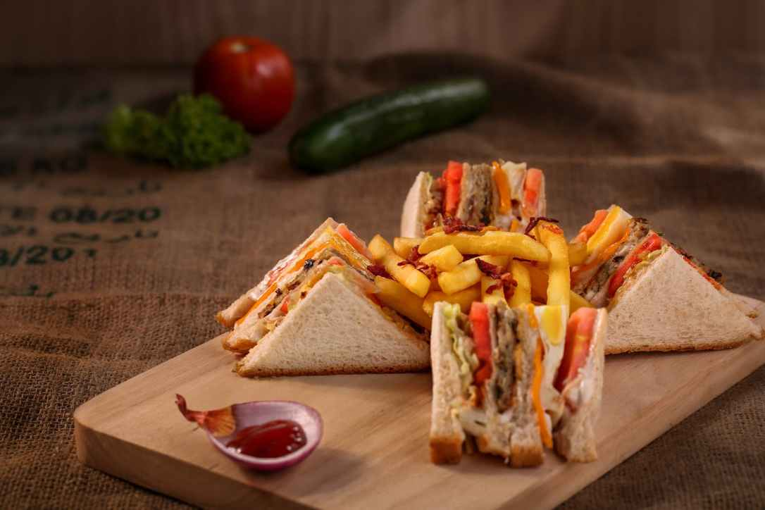 club sandwich served on chopping board