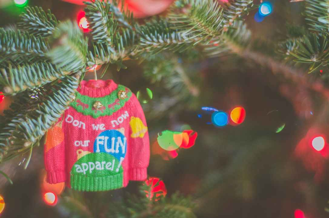 selective focus photo of sweater christmas tree ornament