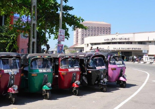 Tuktuks lined up by Galle railway station.