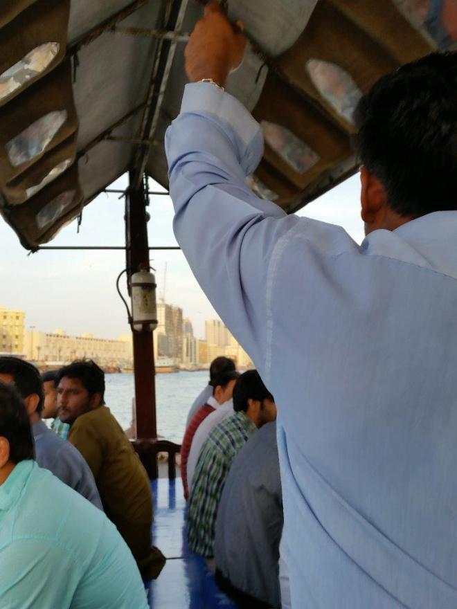 Crossing the Khor Dubai river in a wooden abra.