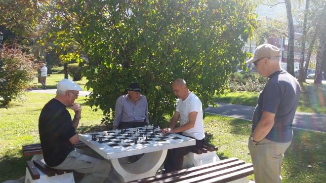 Men playing chess in the park in Brasov
