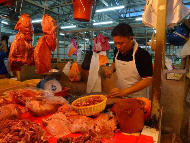 Butcher at Farmers market in Jalan Raja Alang, KL, Malaysia. Food tour in Kuala Lumpur, Malaysia