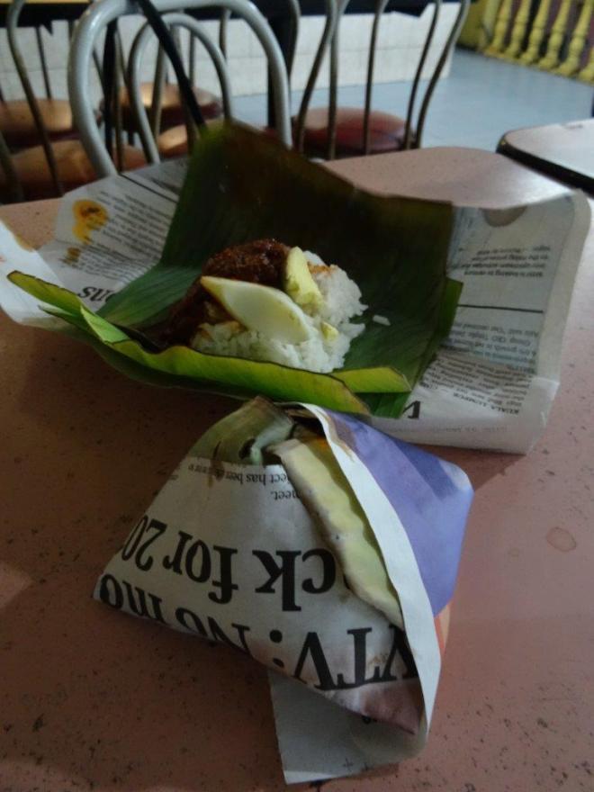 Rice in palm leaf. Food tour in Kuala Lumpur, Malaysia