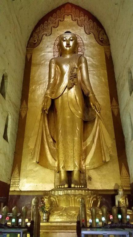 Statue in gold plated teak inside Ananda Phaya, Bagan, Myanmar