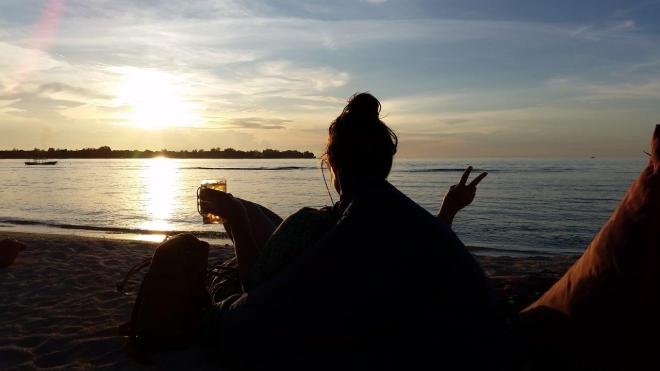 The perfect ending of the day. Sunset and beer at the beach. Gili Meno island, Indonesia
