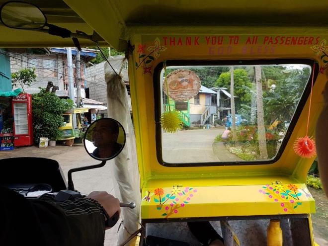 Driving through local villages on our way to Puka Beach. Boracay Island, The Philippines.