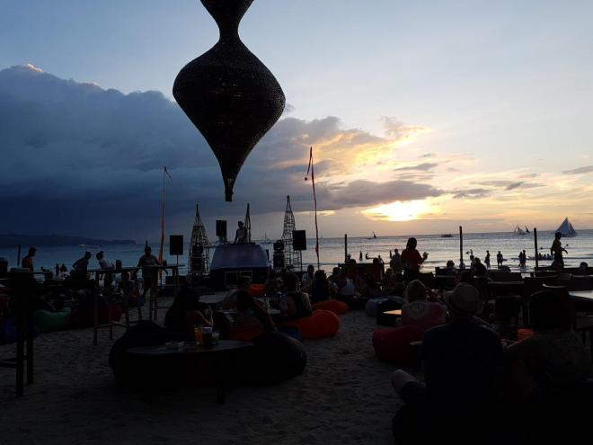 Relaxing mood sitting in a bean bag at the beach. Boracay Island, The Philippines