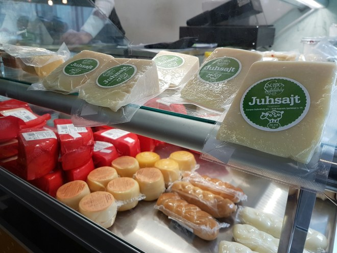 Local cheese produce sold at the market in Buda. Taste Hungary food tour. Budapest, Hungary.